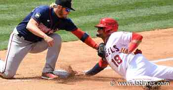 Angels split doubleheader with Twins