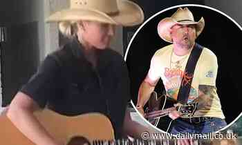 Jason Aldean's wife Brittany imitates the country music star as she shows off her guitar moves - Daily Mail