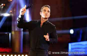 Robbie Williams is playing himself in his upcoming biopic - The Times Herald