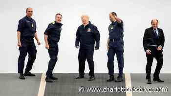 Queen Elizabeth II visits carrier ahead of maiden deployment - Charlotte Observer