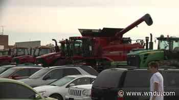 New Prairie High School seniors celebrate by driving tractors to school - WNDU-TV