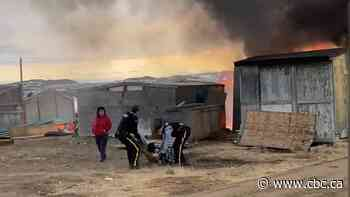 Multiple shacks burned down, 1 person carried from Iqaluit fire - CBC.ca