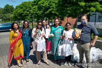 Jaïnvrouwen houden voedselbedeling (Wilrijk) - Het Nieuwsblad