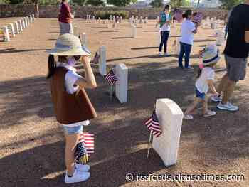 Youth groups place American flags at Fort Bliss Cemetery for Memorial Day