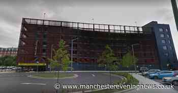 Emergency services rescue man from roof of car park near Stockport station - Manchester Evening News