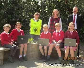 Binsted pupils get laptops from Lions | News - Farnham Herald