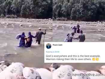 WATCH | J&K: Medics Wade Through River With Knee-Deep Water To Vaccinate Residents In Remote Area - ABP Live