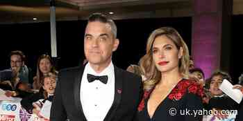 Robbie Williams shows off completely bald new look after wife Ayda Field shaves his head - Yahoo News UK