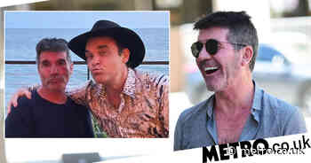 Simon Cowell shows off best pout on double date with Robbie Williams - Metro.co.uk