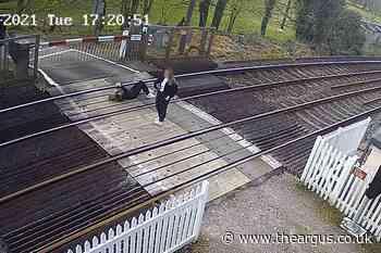 Warning as teen caught on CCTV lying on Horsham railway