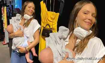 Katharine McPhee breastfeeds her son Rennie while shopping at Dolce & Gabbana