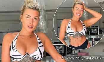 Love Island's Olivia Bowen showcases her tattooed body in a  bikini as she poses in her kitchen