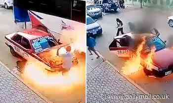Moment Mexican taxi explodes in flames as driver checks problem with the engine