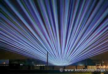 Massive laser show lights up night sky