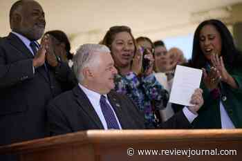 Sisolak signs mail voting, presidential primary bills into law