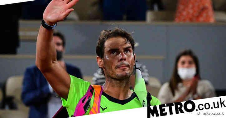 Rafael Nadal reacts after unbeaten French Open streak is snapped by Novak Djokovic