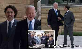 Biden's G7 bromances: President wraps his arm around Macron and jokes around with Trudeau