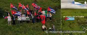 """Desde montaña irlandesa ondea una gigante bandera cubana con un mensaje claro al presidente Biden: """"UNBLOCKCUBA"""". - Ministerio de Relaciones Exteriores Cubano"""