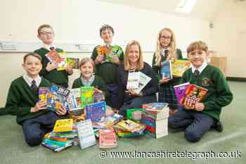 Housebuilder contributes to Barrow school library