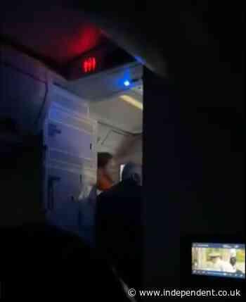 Passengers and crew scramble to restrain man attempting to open door of Delta flight