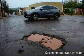 Chuvas provocam buracos em Campo Grande - Correio do Estado