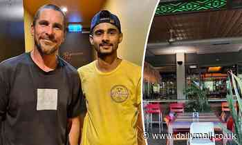 Christian Bale smiles for a photo with a fan at a Mexican Restaurant in Darwin