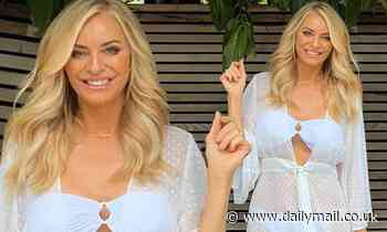 Tess Daly, 52, wows in a strapless bikini and see-through coverup as she poses for sunny snap