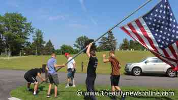 Volunteers set up 26 flags at WNY National Cemetery in Pembroke - The Daily News Online