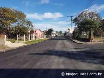 Rua Erlinio Assis recebe melhorias com reperfilagem asfáltica - Blog do Juares