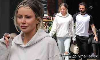 Olivia Attwood teams ripped jeans with a grey hoodie as she leaves restaurant with fiancé Bradley