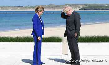 Boris and Carrie swelter in Cornwall as they greet more G7 guests