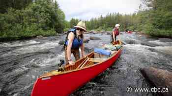 New documentary traces Alberta filmmaker's 'comical' canoe trip with 70-year-old dad
