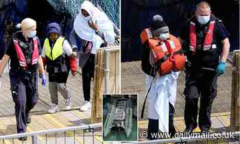 Migrants arrive in Dover after Kent county council said it had reached limit