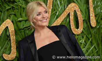 Holly Willoughby wows fans as she sunbathes in blue bikini