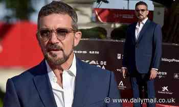 Antonio Banderas, 60, looks dapper in a navy blue suit at film premiere in Malaga