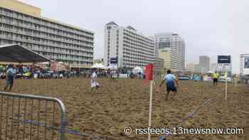 Rainy weather isn't stopping the world's largest beach soccer tournament in Virginia Beach