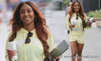 Alexandra Burke puts on a leggy display in a lemon hoodie and matching shorts