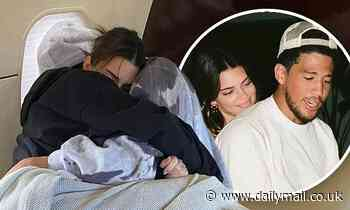 Kendall Jenner straddles beau Devin Booker in the kitchen and cuddles with him on a private plane