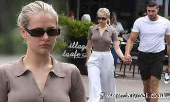 Molly-Mae Hague looks stylish as she strolls hand-in-hand with boyfriend Tommy Fury