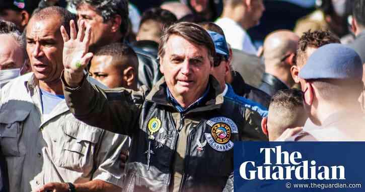 Jair Bolsonaro fined for not wearing mask at São Paulo biker rally – video