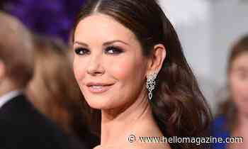 Catherine Zeta-Jones commands attention as she poses in robe inside family kitchen - HELLO!