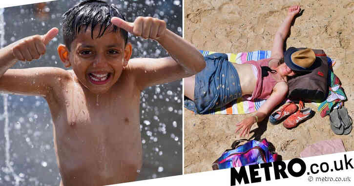 Thousands flock to beaches to enjoy sunshine as temperatures soar to 27.9°C