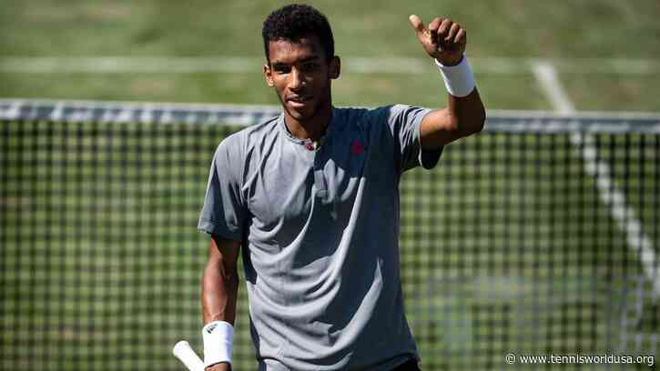 Felix Auger-Aliassime reacts to losing his eighth ATP final