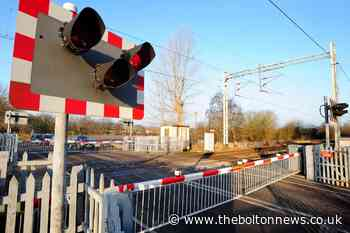 Railway lines blocked after train hits car at level crossing - The Bolton News