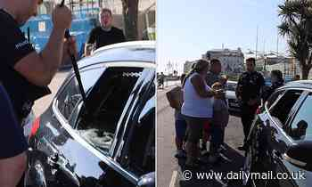 Sussex Police rescue two dogs from boiling car as temperatures soared to 75F in Brighton seafront