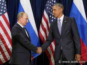 President Vladimir Putin shakes hands with President Barack Obama.jpeg - WDRB