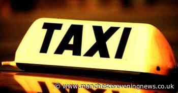 Taxi driver suspended after allegations he was 'carrying a hammer'