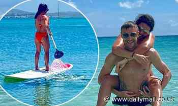 Rebekah Vardy and her husband Jamie enjoy a holiday by the beach