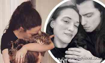 Kat Dennings' fans think she could be wed as her fiance Andrew WK flashes a band