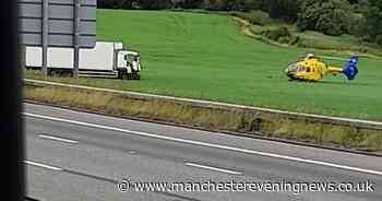 Air ambulance called as lorry crashes off the  M56